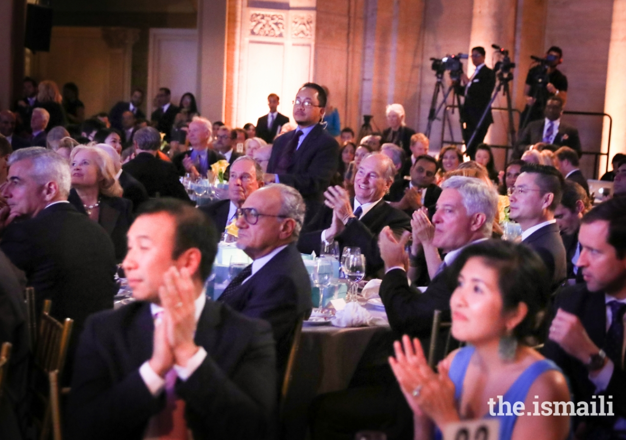 Mawlana Hazar Imam applauds after the musical performance by Wu Tong.