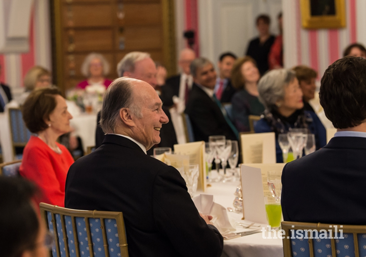 "Mawlana Hazar Imam seated at the head table named ""Burnaby"" in recognition of the Ismaili settlement in the city when they first arrived in Canada and where one of the first Ismaili Centres was built."