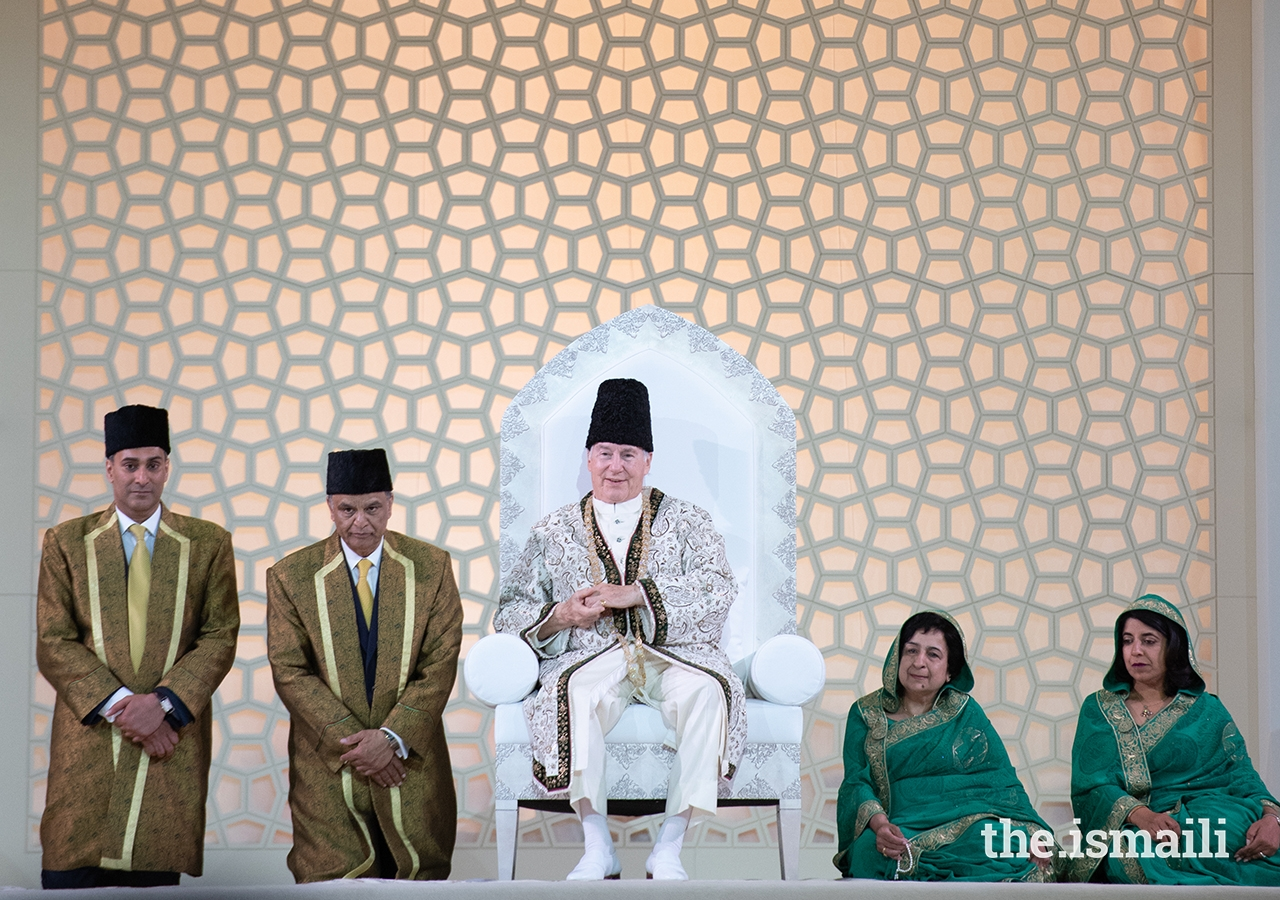Mawlana Hazar Imam at the Diamond Jubilee Darbar in London, with Mukhi Saheb, Kamadia Saheb, Mukhiani Saheba, and Kamadiani Saheba of London Darkhana.