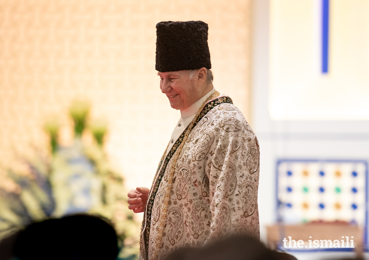 Mawlana Hazar Imam walks through the Jamat during the Diamond Jubilee Darbar in London.