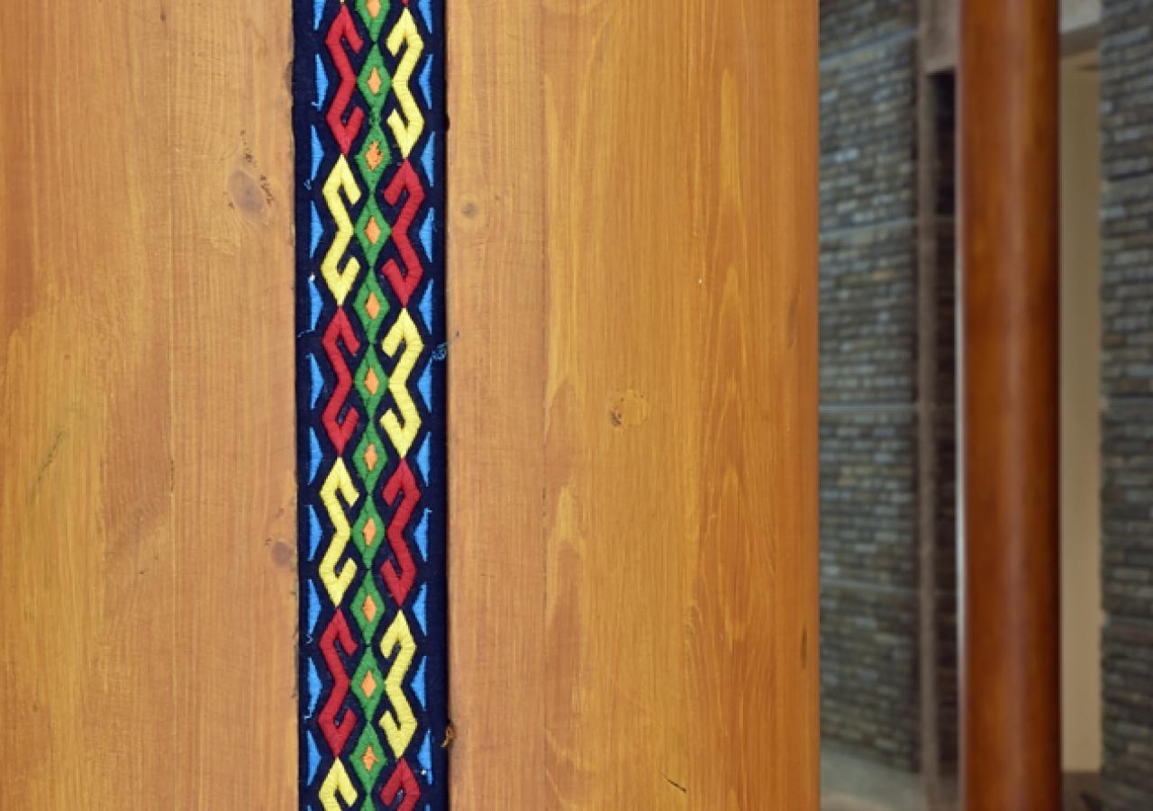 Inlaid fabric pattern on wood columns at the Ismaili Jamatkhana and Centre, Khorog.