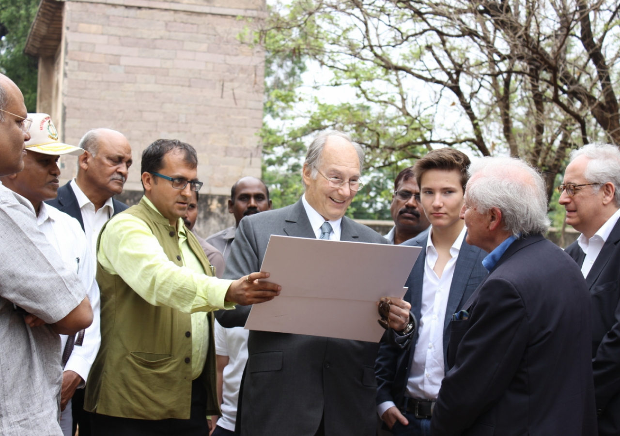 Mawlana Hazar Imam is shown archival photographs of the Tomb of Ibrahim Qutb Shah as Prince Aly Muhammad looks on. AKDN / Lipi Bharadwaj