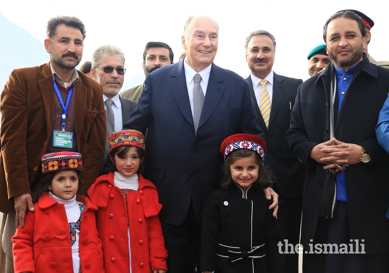 Mawlana Hazar Imam joins children for a group photograph at the Gilgit airport