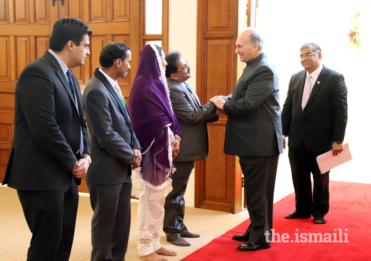 Mawlana Hazar Imam greets local leadership upon his arrival at Clifton Jamatkhana, Karachi