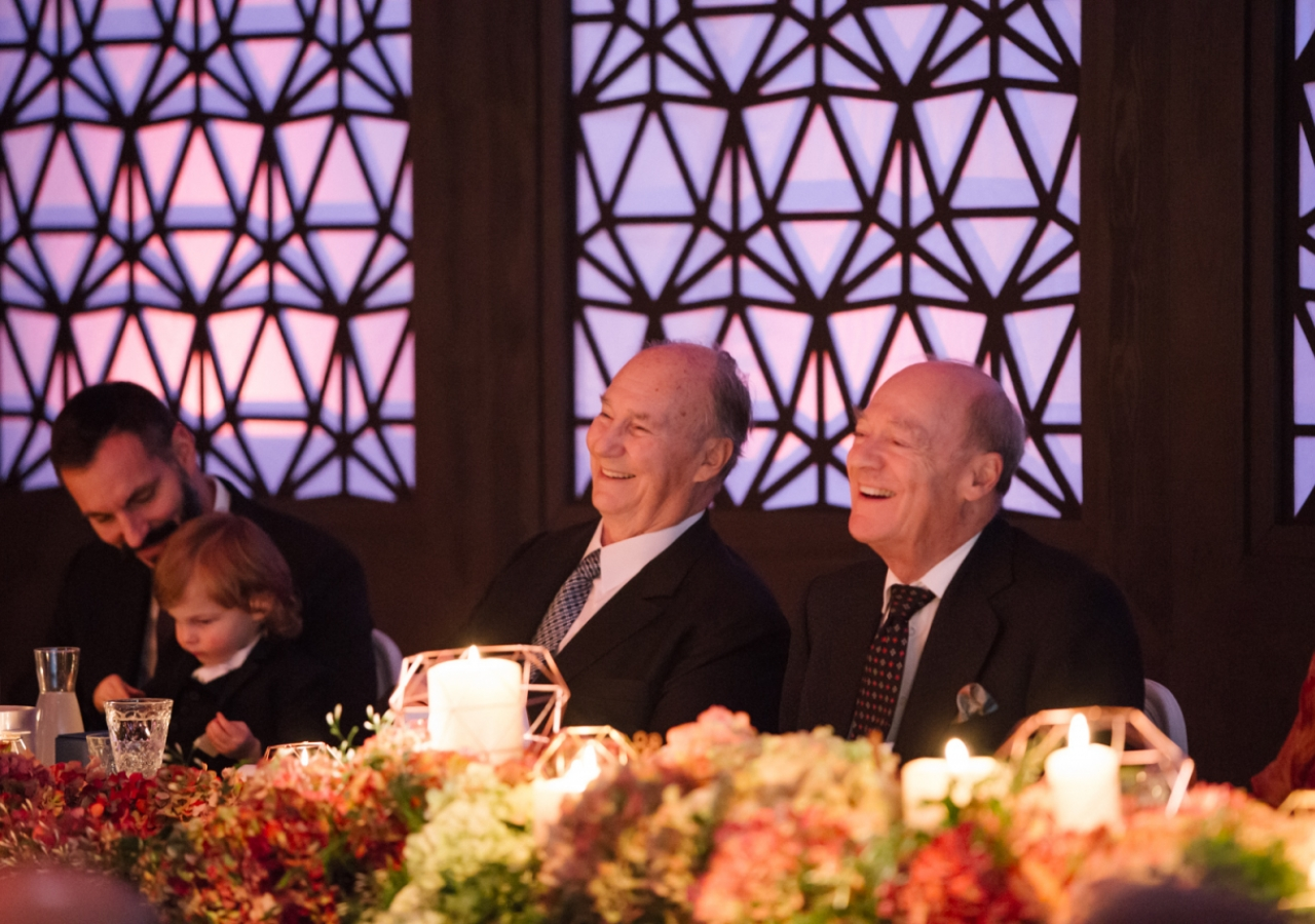 Mawlana Hazar Imam and Prince Amyn share in laughter during Chairman Eboo's address. Photo: Farhez Rayani