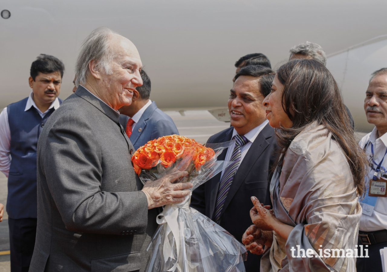 President of the Ismaili Council for Western India Aslam Lilani and his wife welcome Mawlana Hazar Imam with a bouquet of flowers upon his arrival in Mumbai.