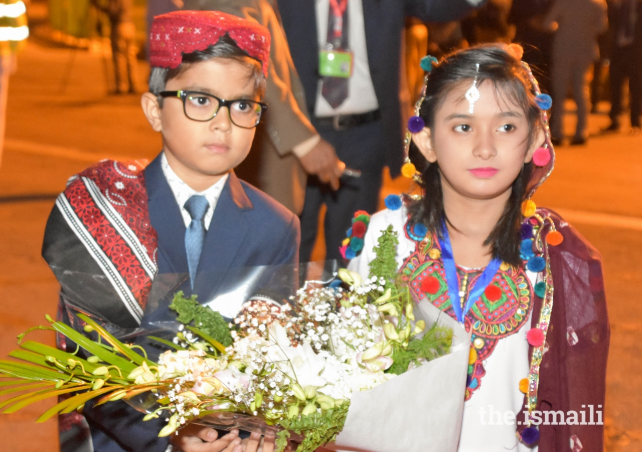 Young children prepare to present a bouquet of flowers to Mawlana Hazar Imam upon his arrival