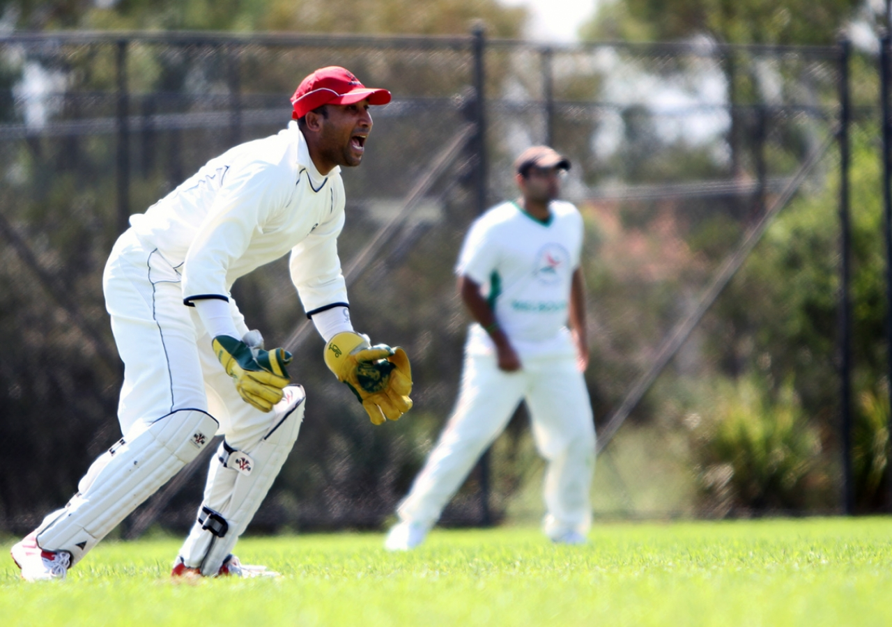 Faisal Hussaini, Melbourne A's captain and wicket keeper, motivating the bowler. Ismaili Council for ANZ