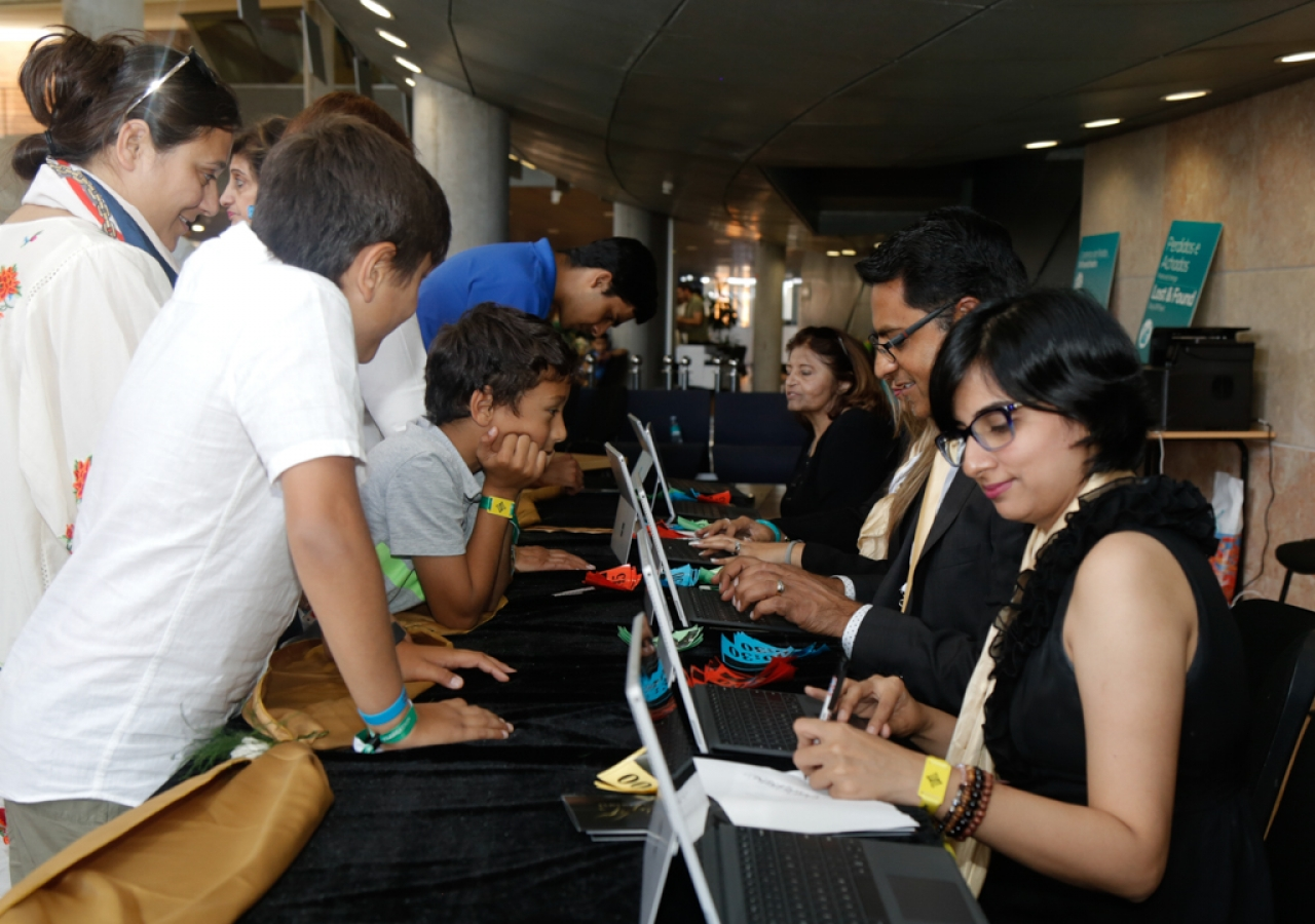 Registration volunteers help Jamati members check- in for the Diamond Jubilee Celebration Lisboa 2018.