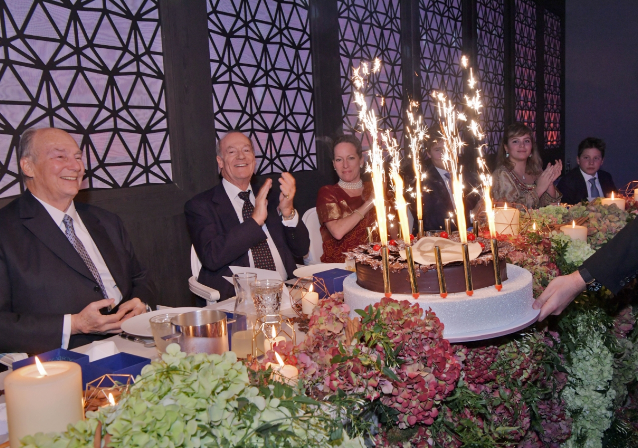 Members of Hazar Imam's family applaud as the birthday cake is presented to Mawlana Hazar Imam. Photo: Zahur Ramji