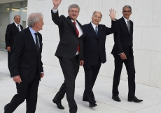 Mawlana Hazar Imam and Prime Minister Harper wave as they walk past the entrance of the Ismaili Centre, together with Luis Montreal, Director General of the Aga Khan Trust for Culture and Malik Talib, President of the Ismaili Council. Zahur Ramji