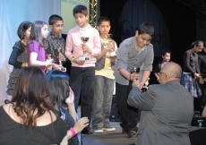 Under-11 Football participants receive their trophies.