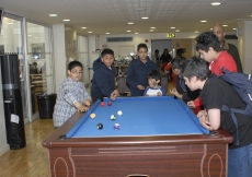 "Children enjoying a game of pool in the Youth Club Network ""Chill-Out Zone"""