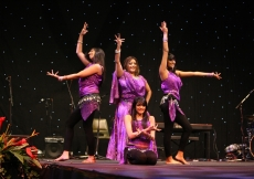 Bollywood dancers entertain the audience.
