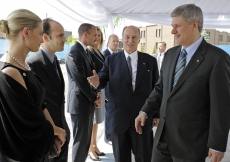 Mawlana Hazar Imam presenting Prince Hussain and Princess Khaliya to Prime Minister Stephen Harper, upon Hazar Imam and the Prime Minister's arrival for the Foundation Ceremony in Toronto.