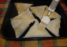 17. Brush the samosas lightly with oil on both sides.