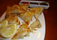 19. Serve the samosas hot, together with fresh lemon wedges.