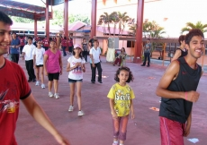 Participants join in a warm-up session ahead of the Sports Day's main events.