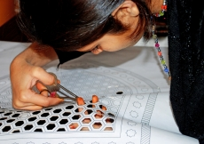 A young girl from Nizamuddin Basti cuts sanjhi patterns. Raising awareness among residents about the rich cultural heritage of the neighbourhood they live in is part of the conservation effort.