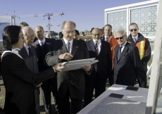 Fumihiko Maki and Gary Kamemoto of Maki & Associates review cladding stone for the Aga Khan Museum with Mawlana Hazar Imam in October 2010.