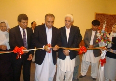 The ribbon cutting at the opening of Chamandi Jamatkhana is performed by Aitmadi Karimdad Mehri, President Rai Shair Baz Hakemy, Vice-President Karim Bakhsh Hashuri, and ITREB Executive Officer Niamatullah Mohammadi.