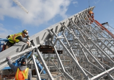May 2011: Construction workers carefully assemble the frame of the glass roof of the Ismaili Centre, Toronto.