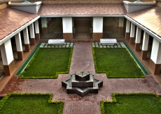 Functional areas of the building are arranged around the Centre Courtyard with the Social Hall on the right, the Administrative Corridor on the left, and the Prayer Hall in the front.