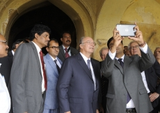 The Aga Khan Trust for Culture team demonstrates an Augmented Reality App developed especially for the Qutub Shahi Tombs Site. (Hyderabad, 2013) AKDN / Gary Otte