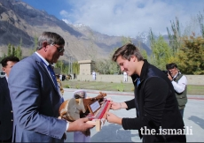 Prince Aly Muhammad is presented a traditional musical instrument upon his arrival in Aliabad, Hunza, Gilgit-Baltitsan