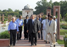 Mawlana Hazar Imam, accompanied by Prince Hussain and officials from the Aga Khan Trust for Culture, walks down the central axis of the Sunder Nursery — once known as Azim Bagh (great garden) — after visiting  the Sunder Burj, a 16th century tomb restored
