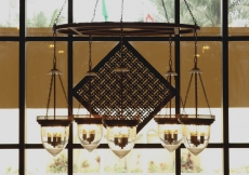 The square-in-square motif is visible in this etched glass chandelier hanging in the Ismaili Jamatkhana and Centre, Kinshasa.