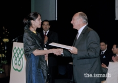 Mawlana Hazar Imam presenting certificates to the Class of 2004 of the Graduate Programme in Islamic Studies and Humanities - 25th Anniversary of the Institute of Ismaili Studies, London, 19 October 2003.