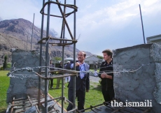 Prince Aly Muhammad learns about the impact of seismic resistant technology in Singal, Ishkoman Puniyal, Gilgit-Baltistan