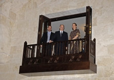 Mawlana Hazar Imam together with Prince Rahim and Princess Zahra overlooking the entrance hall of the Ismaili Centre Dubai from the balcony above.