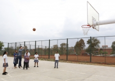 Prince Aly Muhammad shoots for the basket as Sara, Iliyan and students at the Aga Khan Academy, Hyderabad cheer him on! Nazim Lokhandwala