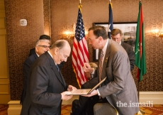 Representative Pete Olson presents Mawlana Hazar Imam with a Congressional Proclamation.