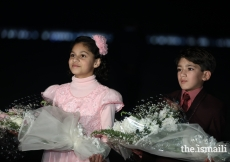Young children waiting to present bouquets to Mawlana Hazar Imam