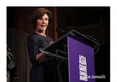Former First Lady of the United States, Laura Bush introduces Sesame Workshop as an award recipient, alongside First Lady of Afghanistan, Rula Ghani.