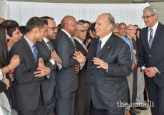 Mawlana Hazar Imam shares a light moment with Jamati representatives upon his arrival in Calgary.