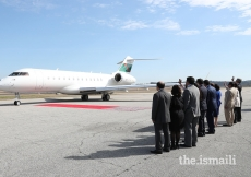 Jamati leaders wave goodbye to Mawlana Hazar Imam as he departs for Houston.