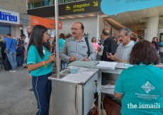 Jamati members check in with volunteers at the Lisbon Airport.