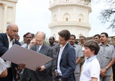 The landscape architect explains to Mawlana Hazar Imam the proposed design for the first phase of work at the Qutb Shahi Heritage Park, as Prince Aly Muhammad and Iliyan listen attentively. AKDN / Lipi Bharadwaj