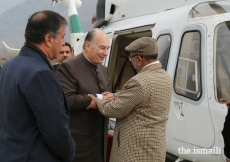 Mawlana Hazar Imam is greeted by Syed Zaheerul Islam, Commissioner, Malakand Division upon his arrival at the Chitral Town Airport