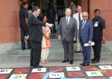 Dr Fisher shows Mawlana Hazar Imam the giant Snakes and Ladders board created as artwork by students and teachers at the Aga Khan Academy, Hyderabad. Ahmed Charania