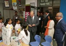 Mawlana Hazar Imam meets students in the Junior School art room, as Principal Sreelatha Kumar and Aga Khan Academies Director Salim Bhatia look on. Ahmed Charania
