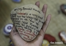 A young student's pebble message, painted at the Jalsa arts event.