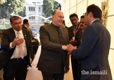 Mawlana Hazar Imam being received upon arrival at Darkhana Jamatkhana, Karachi