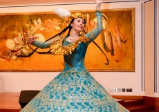 "San'at Mahmudova treats the audience to classic dance styles from Central Asia during ""Threads Along the Silk Road"". Safaraj Khorasi"