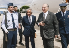 Mawlana Hazar Imam is welcomed by Nazim Ahmad, Head of the Ismaili Imamat's Department for Portugal and other Lusophone countries and Rahim Firozali, President of the Ismaili Council for Portugal.