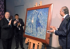 "Mawlana Hazar Imam is presented with a birthday gift on behalf of the global Jamat. Titled ""Horses"", this lapis lazuli mosaic was commissioned from the late Ismail Gulgee in 1989. Photo: Zahur Ramji"